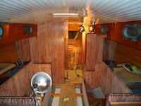 Installing mahogany staving, applying varnish.  Rebuilding an offshore sailboat, sailboat restoration.