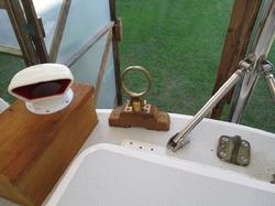Sculling oar on a sailboat, oversize oar lock for sculling oar, bronze oar lock, custom bronze oar lock, pardey sculling.